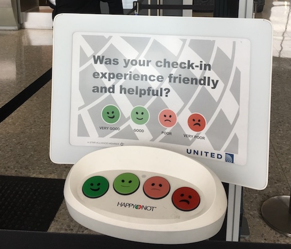 Photo of satisfaction buttons after check-in